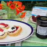 scones and jam in glasshouse copy
